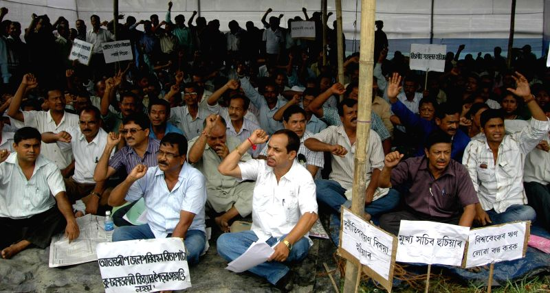Members of Inland Water Transport Employees' Santha stage a demonstration to press for their demands in Guwahati on Aug 13, 2014.