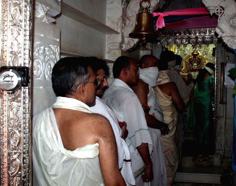 Members of Jain community worship at a Jain temple Paryushan in Ahmedabad on Aug 22, 2014.