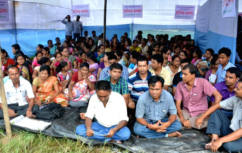 Members of Jyotikendra Siksha Karmi Santha stage a demonstration to press for their demands in Guwahati on Aug 4, 2014.