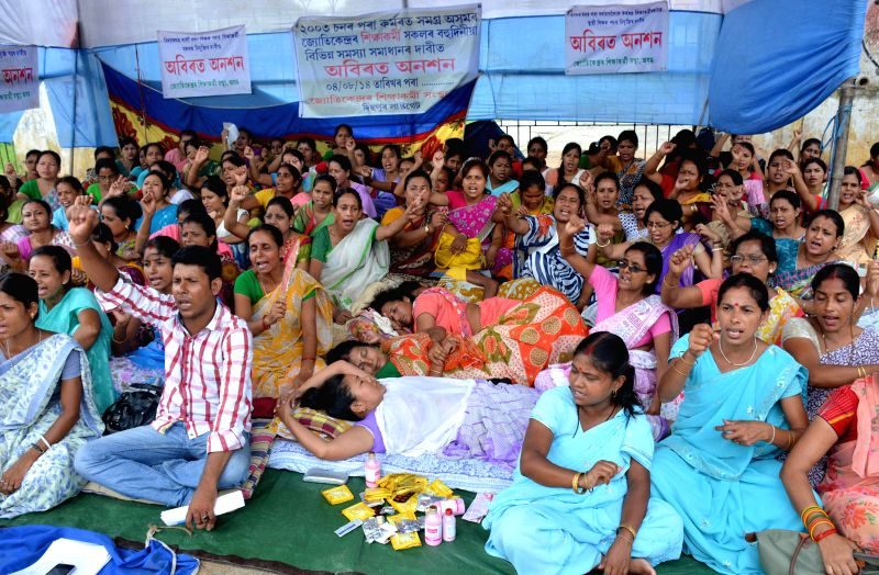 Members of Jyotikendra Siksha Karmi Santha stage a demonstration to press for their demands in Guwahati on Aug 11, 2014.