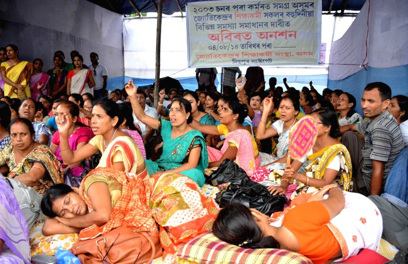 Members of Jyotikendra Siksha Karmi stage a demonstration to press for their demands in Guwahati on Aug 5, 2014.