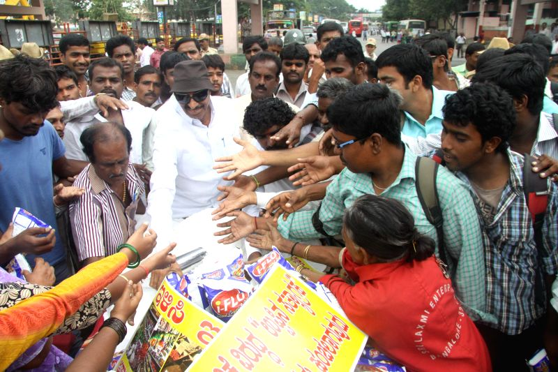 Members of Kannada Chalavali Vatal Paksha led by Vatal Nagaraj distributing salt to people, demonstrating to bring down the prices of daily essential commodities, the protest was held at Kempegowda ..