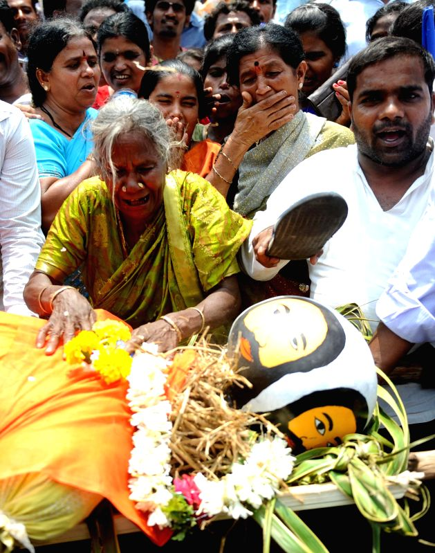 Members of Karnataka Dalita Sangarsha Samiti conduct mock cremation of Yoga guru Ramdev to demonstrate against his anti-dalit remark in Bangalore on April 28, 2014.