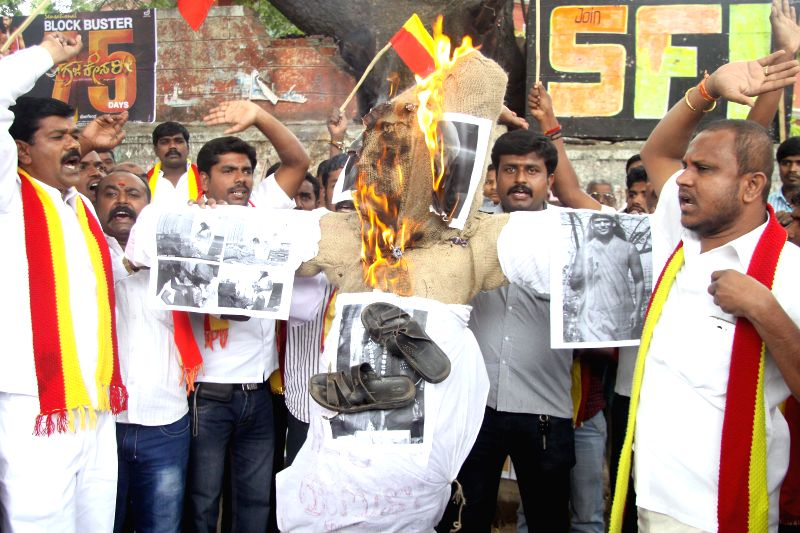 Members of Karnataka Janapara Vedike burn effigies of self-styled godman Nithyananda Swami during a demonstration in Bangalore on Aug 5, 2014.