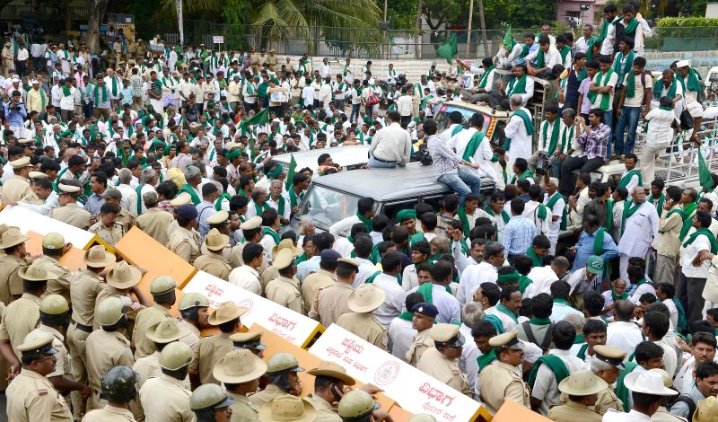 Members of Karnataka Rajya Raita Sangha and Hasiru Sene participate in a rally to press for their demands in Bangalore on June 23, 2014.