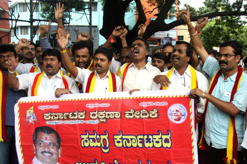 Members of Karnataka Rakhana Vedike protest against the Arrest of TA Narayan Gowda with his team for to their Yellur Chalo campaign, the protest was held at SBM Circle, in Bangalore on August 2, ...