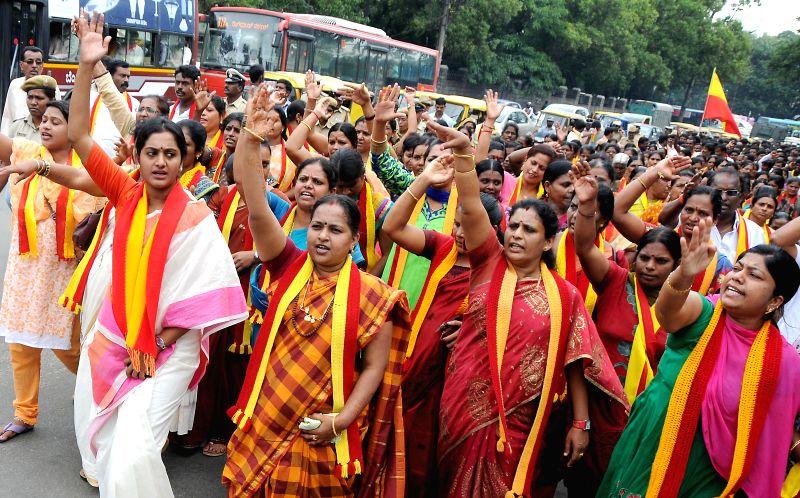 Members of Karnataka Rakshana Vedike demonstrate to protest against attack on Kannadigas in Belagavi, in Bangalore on July 28, 2014.