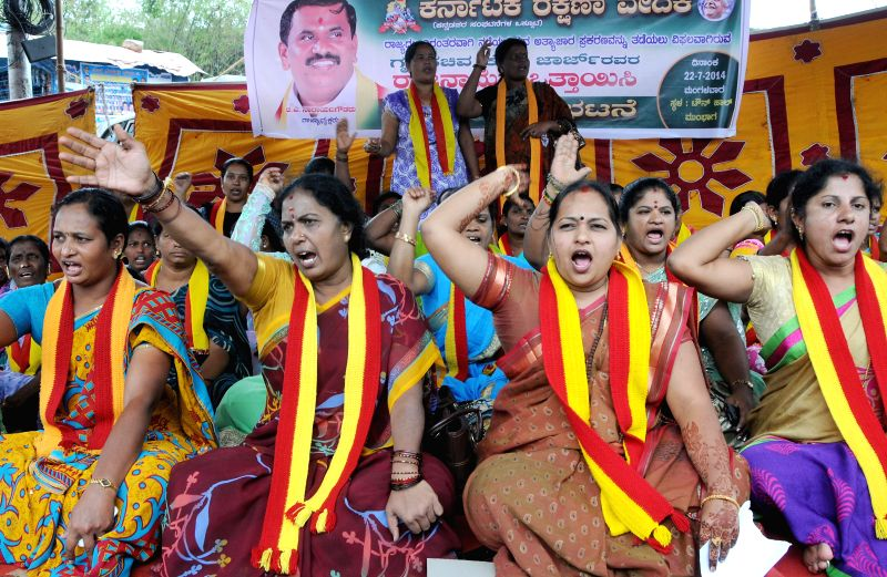 Members of  Karnataka Rakshana Vedike Women wing demonstrate against Siddaramaiah led Karnataka Government for its failure to curb crime against women in the state, in Bangalore on July 22, 2014.