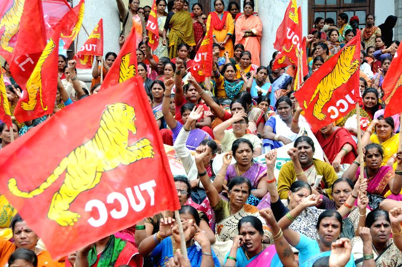 Members of Karnataka State Anganavadi Workers and Helpers Association stage a demonstration to press for their various demands in Bangalore on July 14, 2014.