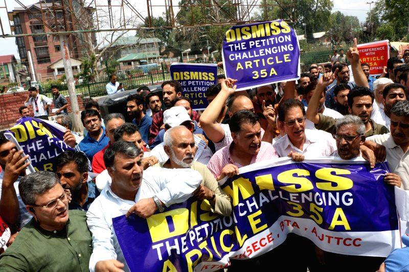 Members of Kashmir Chamber Of Commerce and Industry stage a demonstration against petitions challenging Article 35A in the Supreme Court; in Srinagar on Aug 1, 2018. Article 35A, ...