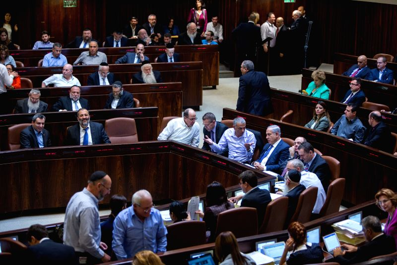 Members of Knesset (Israeli parliament) attend the state budget vote for 2015-2016 at the assembly hall of the Knesset in Jerusalem, on Nov. 18, 2015. The Israeli ...