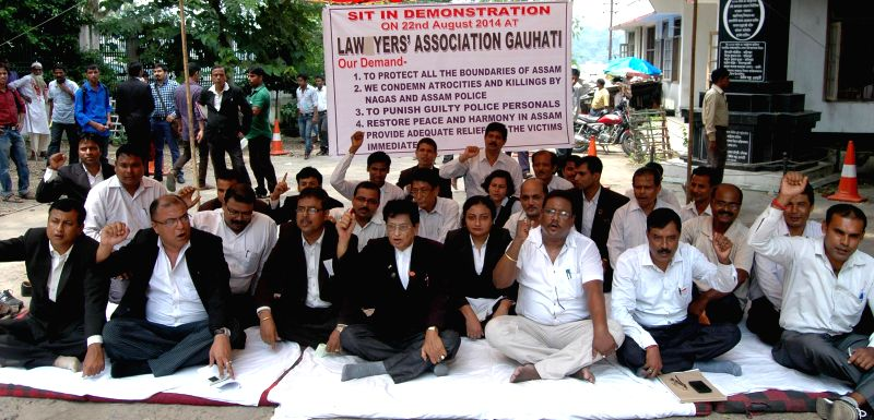 Members of Lawyers' Association Gauhati stage a sit-in demonstration to press for securing all the boundaries of Assam in Guwahati on Aug 22, 2014. Tension has gripped the Assam-Nagaland border since