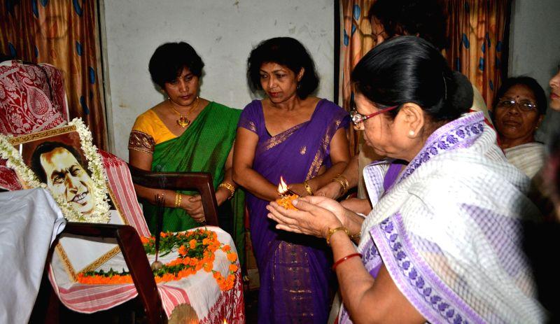 Members of Lekhika Santha pay tribute to Bishnu Prasad Rabha on Bishnu Rabha Divas at Press Club in Guwahati on June 20, 2014.