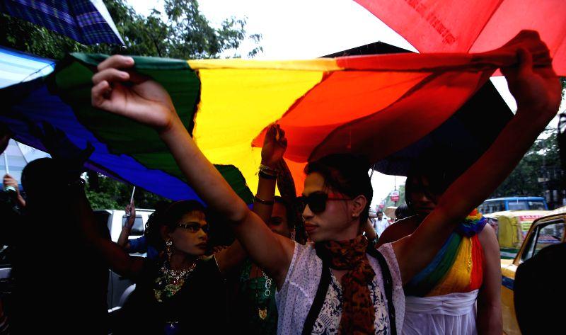 Members of LGBT community participate in Rainbow Pride Walk in Kolkata on July 13, 2014.