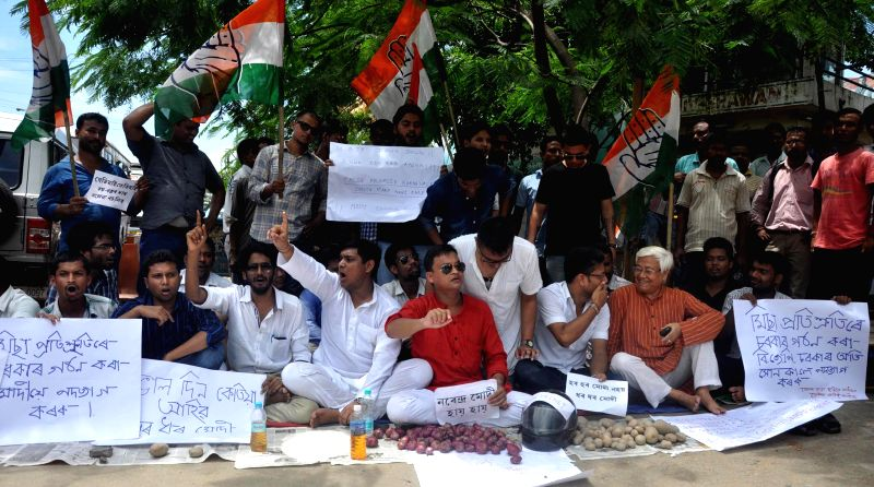 Members of National Student's Union of India (NSUI) and Youth Congress demonstrate against hike in prices of essential commodities at Rajiv Bhawan in Guwahati on July 1, 2014.