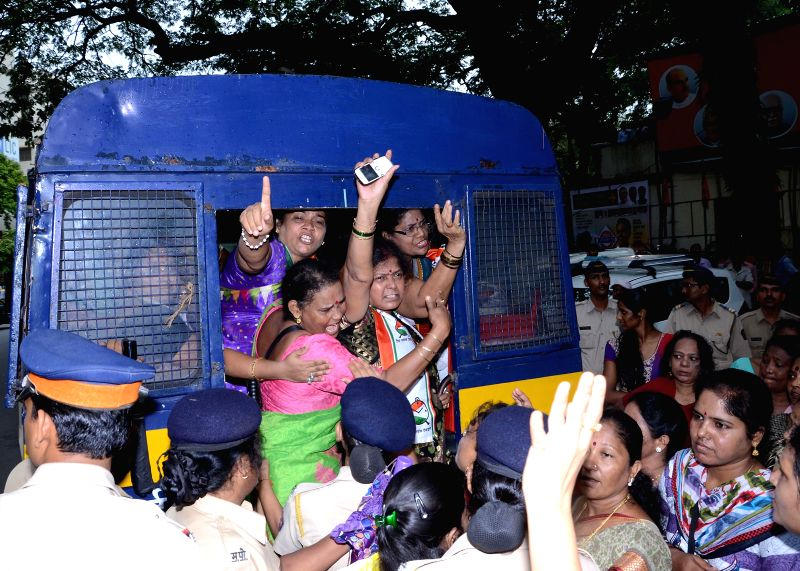 Members of Nationalist Congress Party's Women Cell demonstrating against rail budget 2014-15 at BJP headquarters in Mumbai being taken in police custody on July 8, 2014.