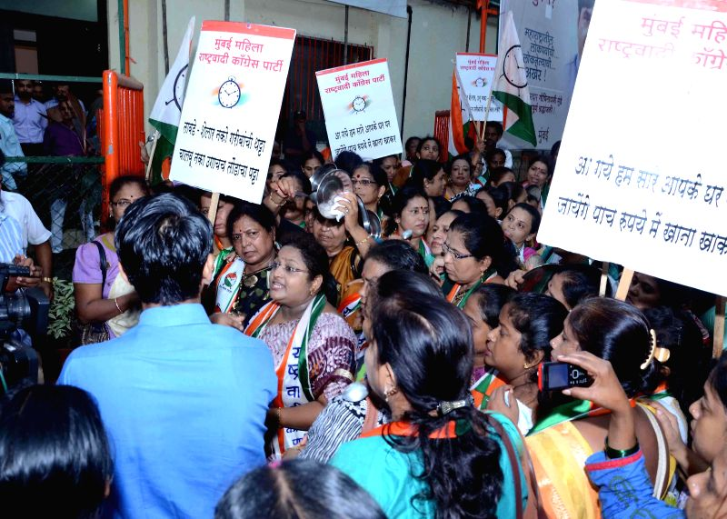 Members of Nationalist Congress Party's Women Cell demonstrate against rail budget 2014-15 which was presented by Union Railway Minister D.V. Sadananda Gowda in the Parliament, at BJP headquarters in - D.