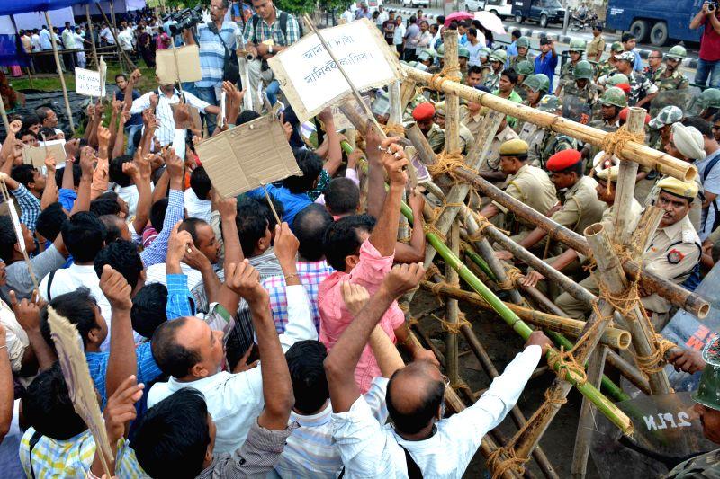 Members of Nimna Prathamik Bidyalayar Karmarata Atirikta Sikshak Santha, Assam (NPBKASS) stage a demonstration to press for their various demands in Guwahati on Aug 4, 2014.