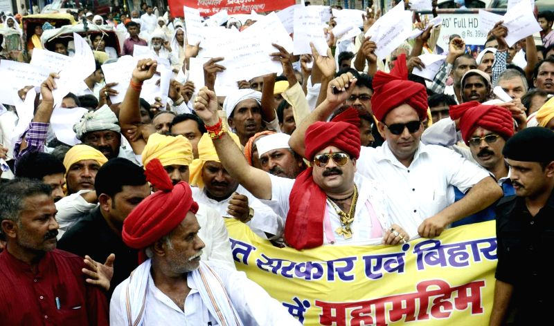 Members of Panch Sarpanch Sangh stage a demonstration to press for their demands in Patna on Sept 3, 2014.
