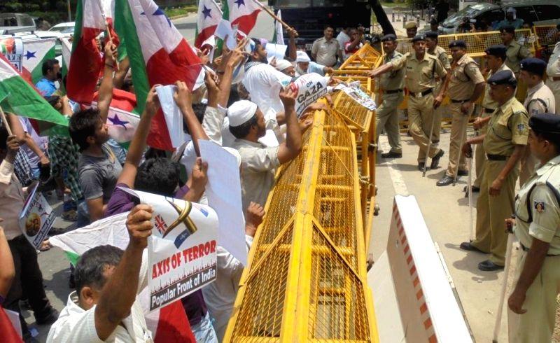 Members of Popular Front demonstrate against Israeli attacks on Gaza, in New Delhi on July 12, 2014.