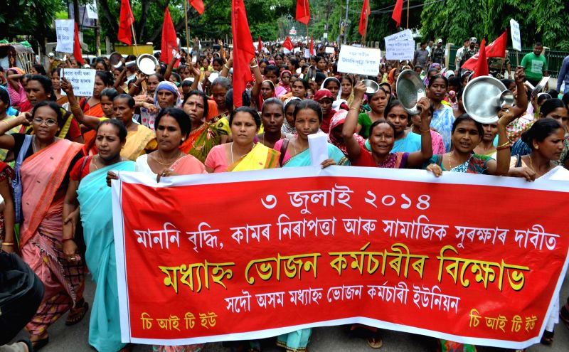 Members of Sadou Asom Mid-Day Meal Workers' Union (SAMDMWU) demonstrate in Guwahati to press for their various demands on July 3, 2014.