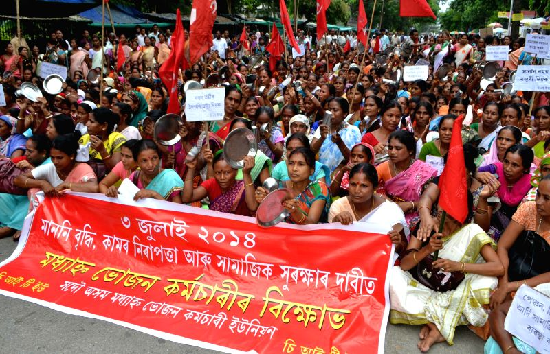 "Members of Sadou Asom Mid-€""Day Meal Workers' Union (SAMDMWU) demonstrate in Guwahati to press for their various demands on July 3, 2014."