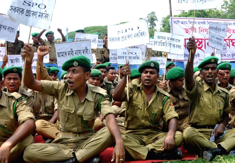 Members of Sadou Asom Special Police Officer (SASPO) sit in protest demanding permanent employment solution in Guwahati on June 16, 2014.