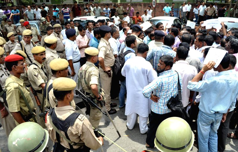Members of Sadou Asom Venture High School Sikshak Santha (SAVHSSS) demonstrate to press for provincialisation of high schools set up after 2006 in Guwahati on July 31, 2014.