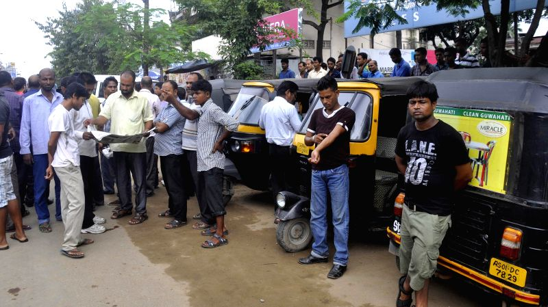 Members of Sadou Guwahati Auto Rickshaw Drivers Union (SGARDU)  protest against the murder of a fellow driver in Guwahati on Aug 12, 2014.