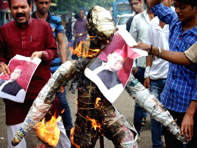 Members of Sanskriti Bachao Manch burn effigy of Uttar Pradesh Chief Minister Akhilesh Yadav during a demonstration against alleged gangrape and forced conversion of a woman in Meerut, Uttar Pradesh; - Akhilesh Yadav