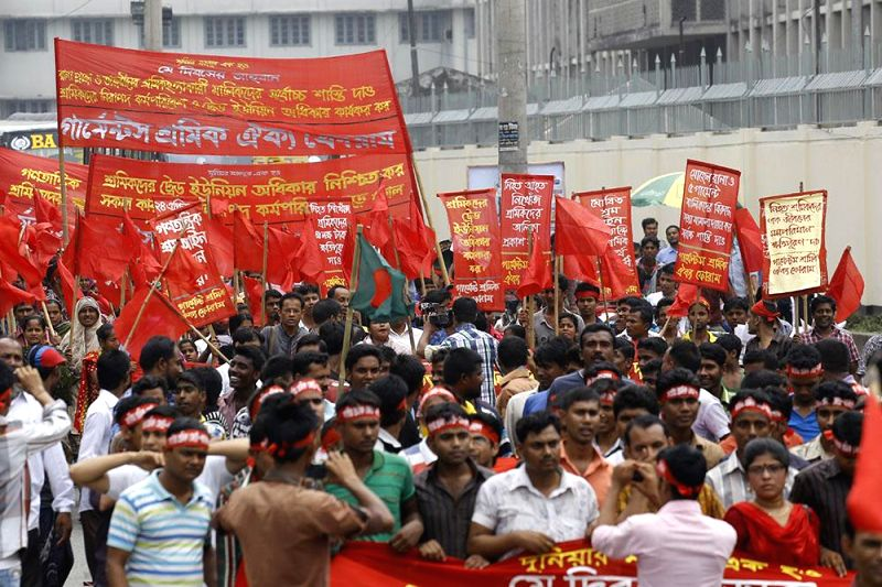 Members of several garment workers' organisations take out a rally to observe International Workers' Day in Dhaka of Bangladesh on May 1, 2014.