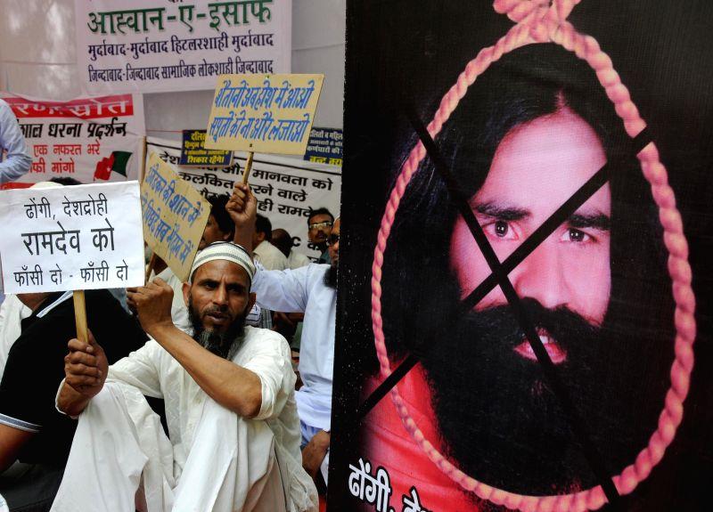 Members of Social Democratic Party of India demonstrate against Yoga guru Ramdev at Jantar Mantar in New Delhi on May 4, 2014.