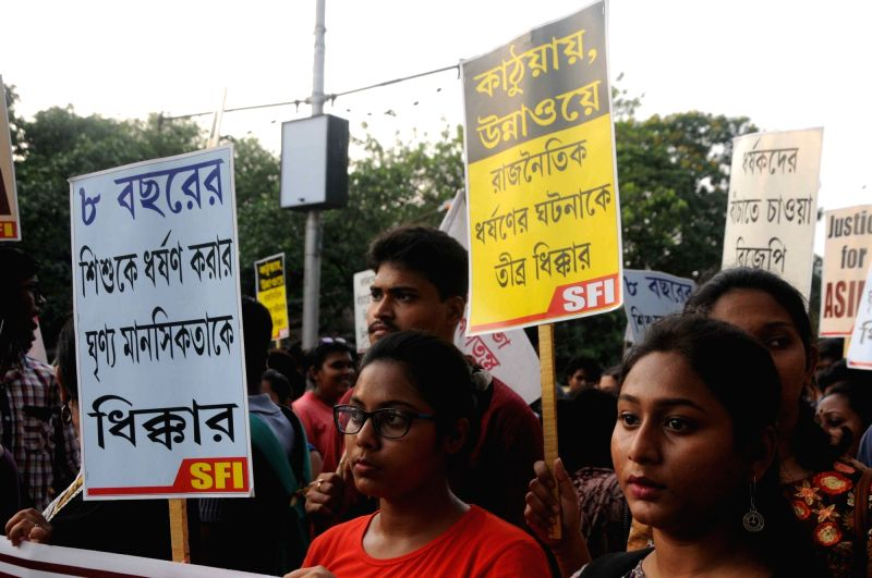 Members of Students' Federation of India (SFI) stage a demonstration against Kathua and Unnao rape incidents, in Kolkata on April 21, 2018.
