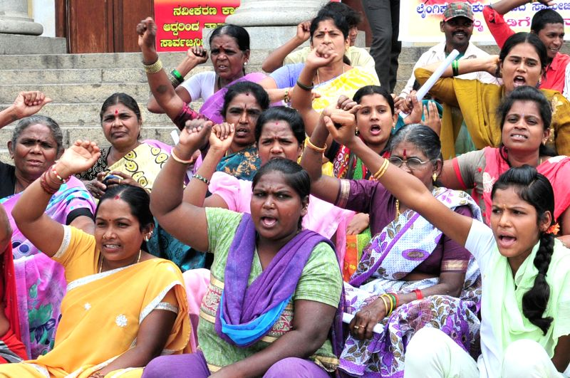 Members of Suvarna Karnataka Women and Child Welfare Service Association stage a demonstration against Ragaveshwara Swamiji of Ramachandrapura Math in Bangalore on Sept 4, 2014.