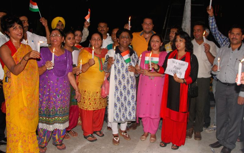 Members of the Akhil Bhartiya Human Rights organisation take part in a candle light march celebrating Indian and Pakistani Independence Day and lighting candles night for the  peace between ...