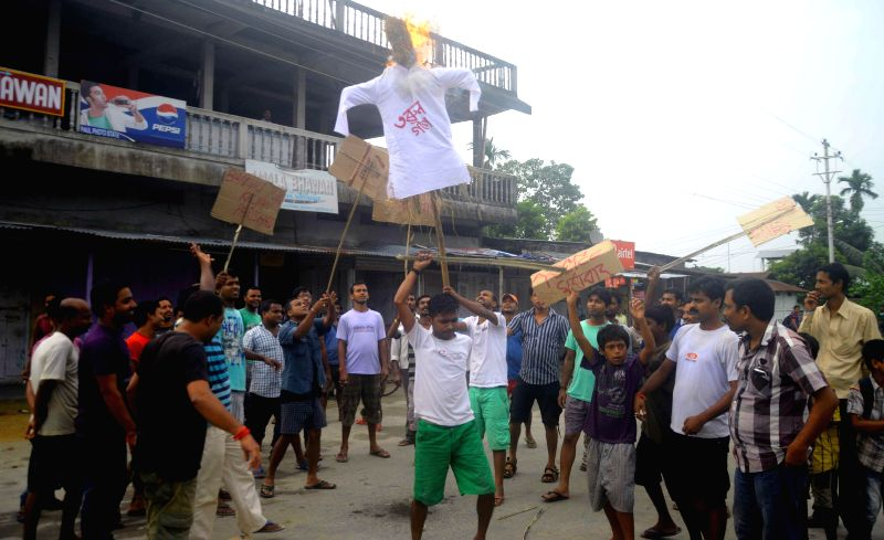 Members of the Bengali Yuva Kaylan Parisad demonstrate against Assam Chief Minister Tarun Gogoi at Patharughat in Assam's Kokrajhar district on Aug 22, 2014. - Tarun Gogoi