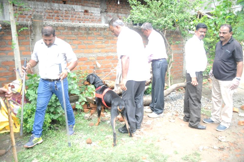 Members of the forensic team carry out investigation at the residence of BJP worker who along with four of his family members were killed, in Nagpur on June 11, 2018. According to the police, ...