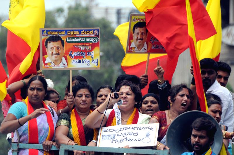 Members of various Kannada organisations demonstrate against crime against women during a strike called by them in Bangalore on July 31, 2014.