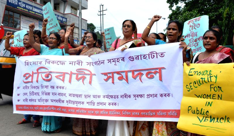 Members of various women organisations participate in a protest rally organised to protest against crime against women in Guwahati on July 7, 2014.
