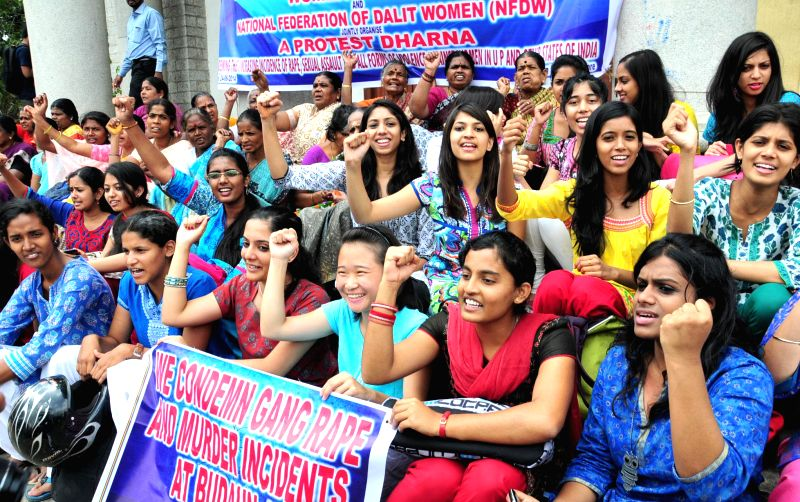 Members of Women Voice and National Federation of Dalit Women demonstrate against Badaun gang rape and murder case in Bangalore on June 24, 2014.