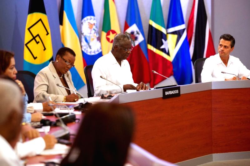 Image provided by Mexico's Presidency shows the III summit between Mexico and the Caribbean Community, in Merida, Yucatan, Mexico, on April 29, 2014. The two-day, ..