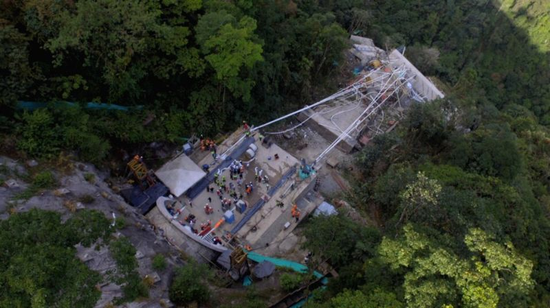 META, Jan. 16, 2018 - A bridge under construction collapses in Meta Department, central Colombia, Jan. 15, 2018. At least 10 people were killed on Monday in the accident.