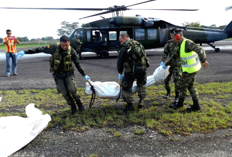 Soldiers transport a body in Meta department, Colombia, on March 22, 2015. A Colombian army soldier and at least three rebels of the Revolutionary Armed Forces of ...