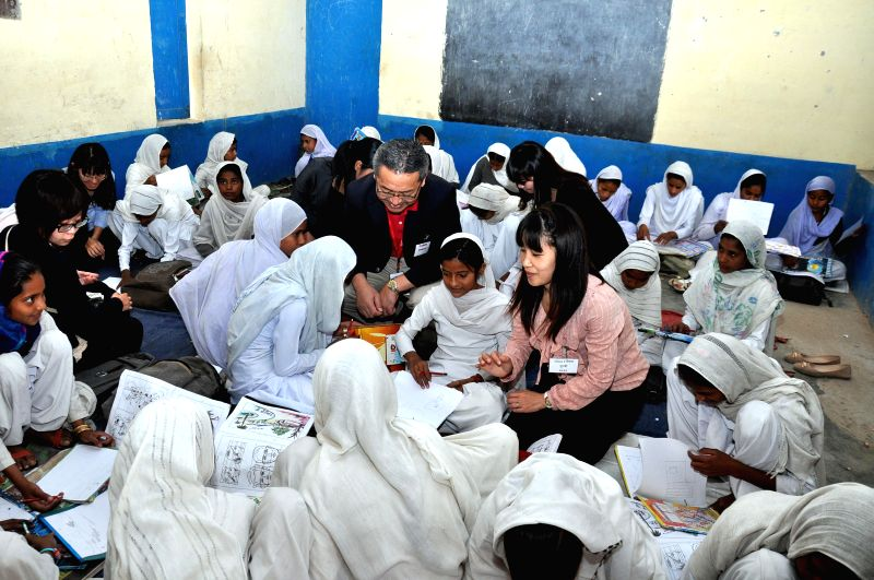 President and CEO of Canon Hongkong Co., Ltd. Kazutada Kobayash and teachers from the Japanese School interacts with school children of Canon`s Adopt a village programme in Ferozepur Namak, ...