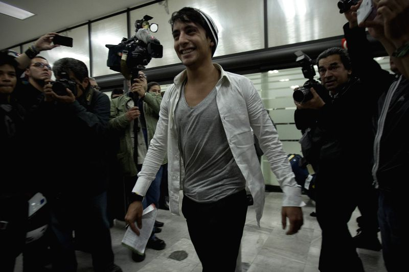 Mexico City: Adan Cortes Salas (C), the Mexican student who disrupted the Nobel Peace Prize ceremony in Oslo last week,  arrives at the airport in Mexico City after being deported from Norway, Dec. ..