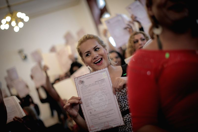 Paulo Herrera reacts at the end of a handing over ceremony of birth certificates for transgendered people in the Legislative Assembly of Federal District ...