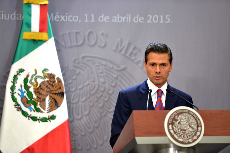 Image provided by Mexico's Presidency shows Mexican President Enrique Pena Nieto delivering a speech during a press conference after attending the 7th Summit ...