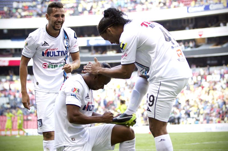 Queretaro's Ronaldinho (R) celebrates his score during the match corresponding to the Day 14 of the 2015 Closing Tournament of the MX League against America, ...