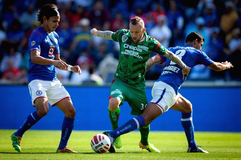 Cruz Azul's Francisco Rodriguez (R) vies with Jaguares's Vicente Matias Vuoso (C) during the match of Closing Tournament of MX League in the Azul Stadium in ...