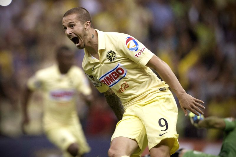 America's Dario Benedetto celebrates after scoring during the second-leg semifinal match of the Confederation of North, Central American and Caribbean ...